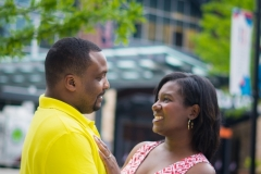 Engagement couple standing in portrait session at Brave's stadium