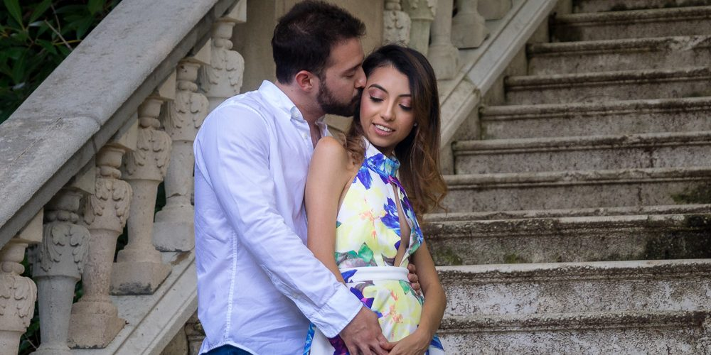 Engagement couple standing side by side on staircase during photo session