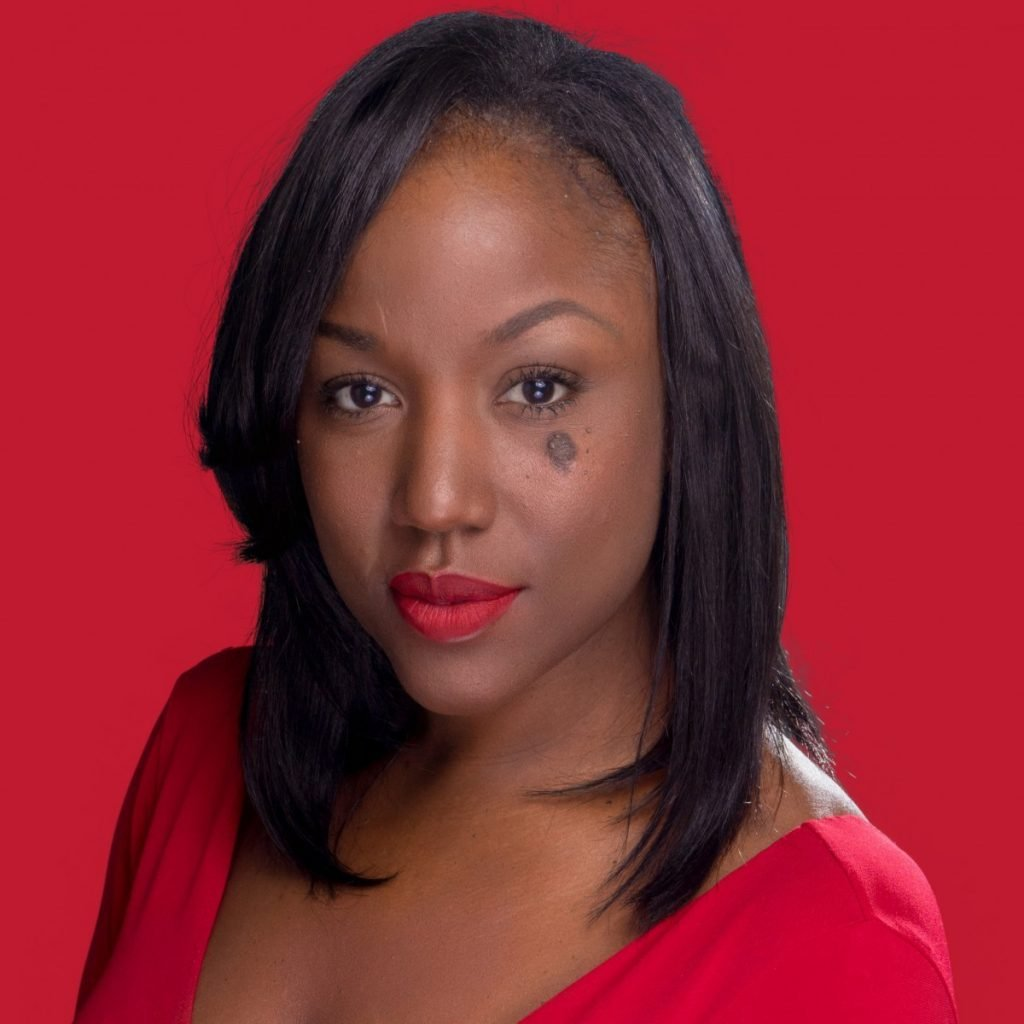 creative studio headshot of black woman in front of red background