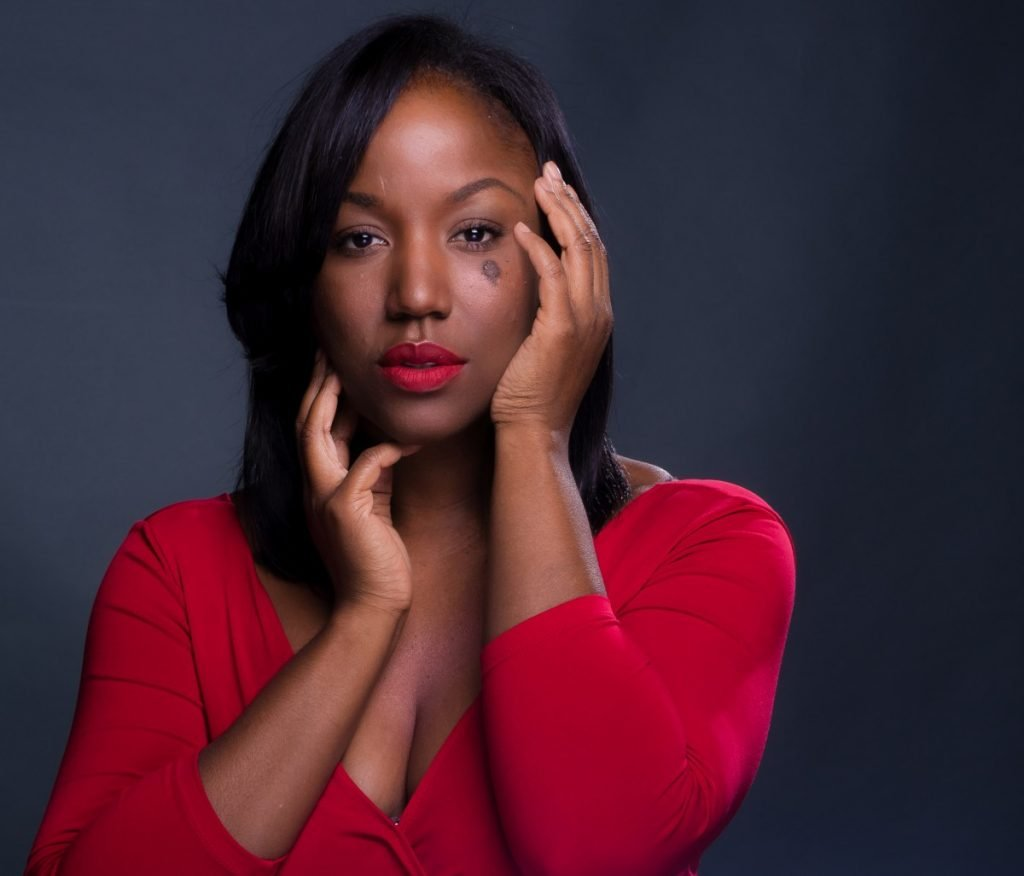 modern studio headshot of black woman in red dress