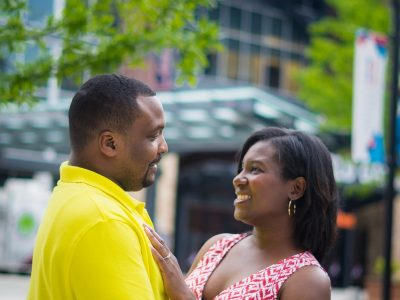 couple standing during an engagement portrait session at Brave's stadium